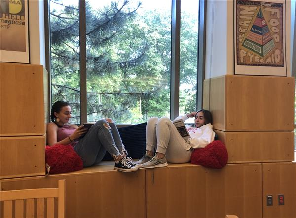 Students enjoying the new reading nook.